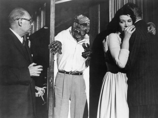 THE HIDEOUS SUN DEMON, Robert Clarke (in doorway), Patricia Manning (second from right), 1959
